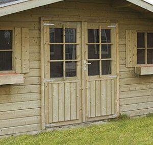 Zanglijster S103: ruim tuinhuis met zadeldak en sierlijke voorluifel.